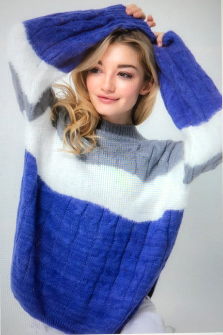 Fuzzy cable knit/color block sweater