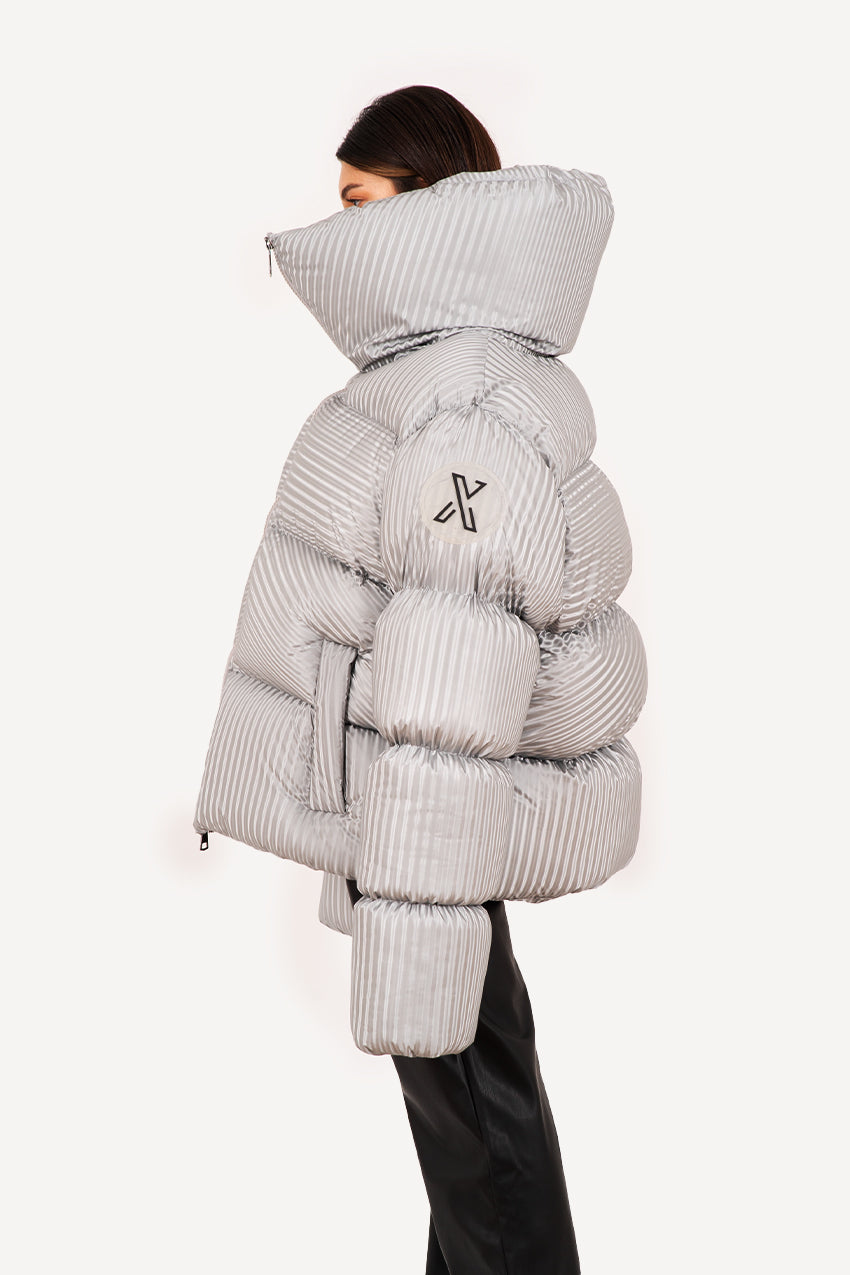 Diagonal patterned giant silver puffer coat