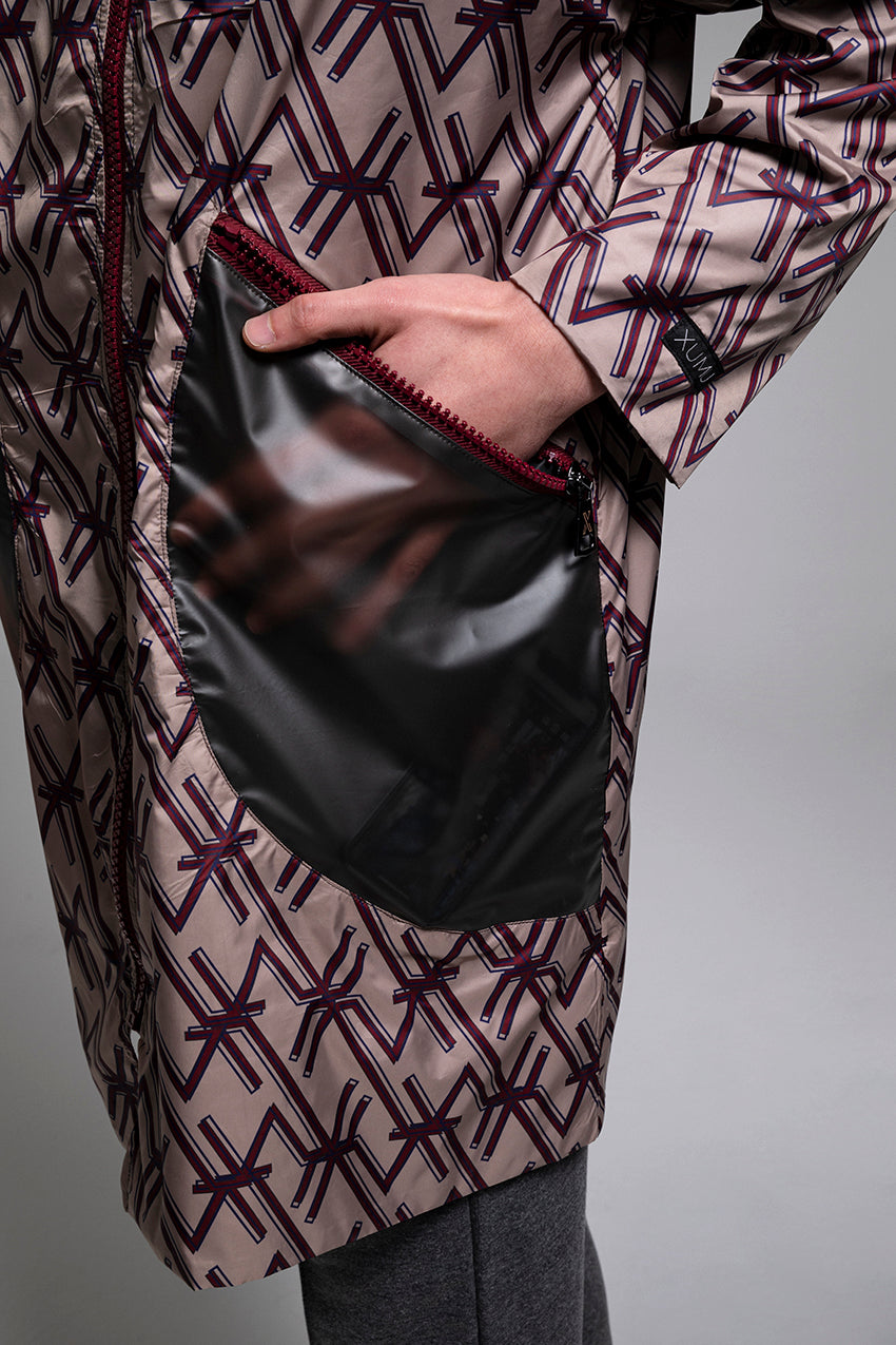 Ephemeris, a special patterned raincoat with dark finishes