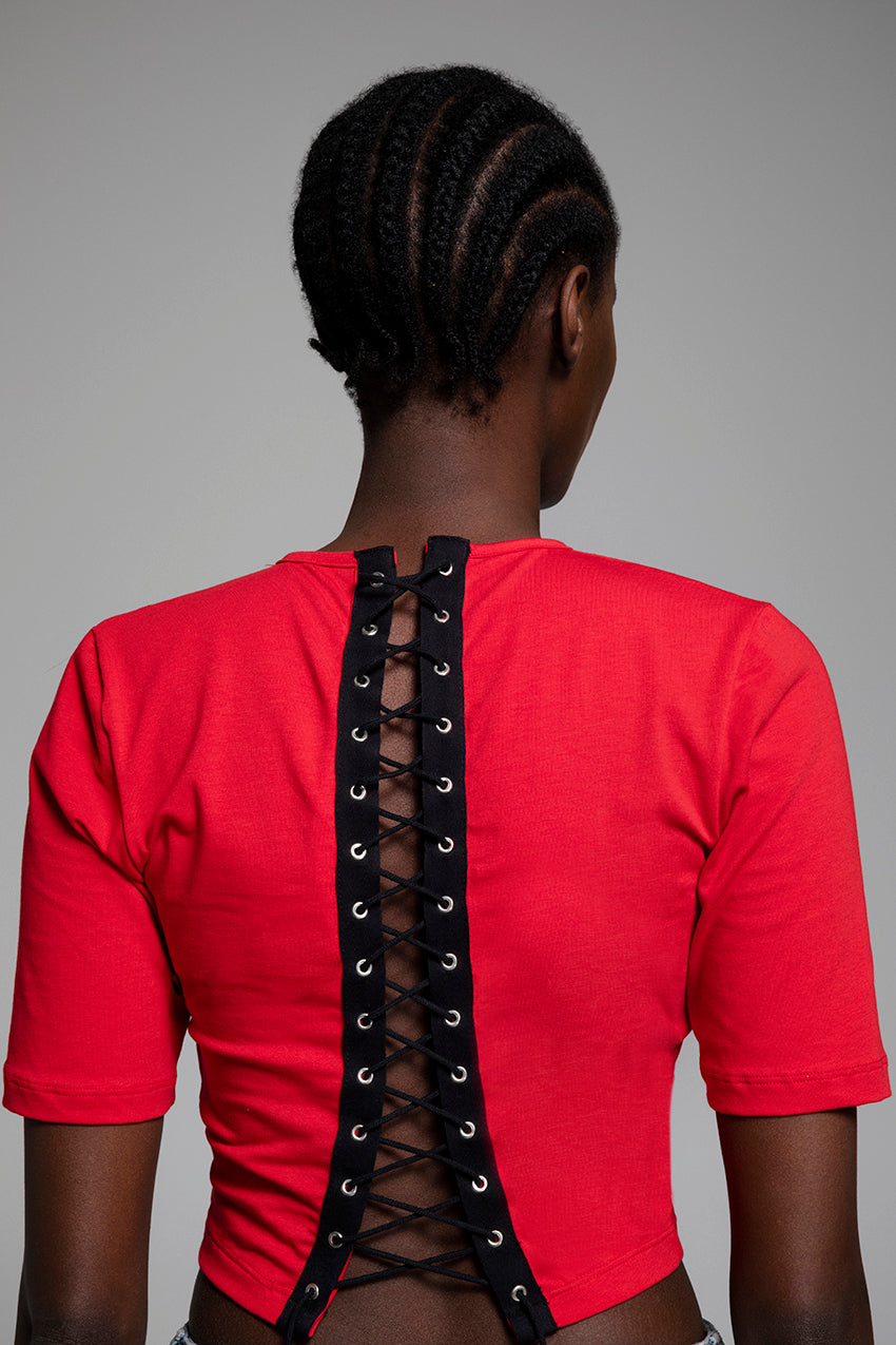 Sensation, a tight crop top with lacings