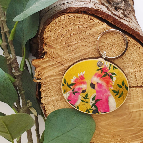 Bright yellow cocktail wooden keychain with  leaves illustration
