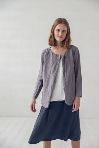 Picture of model wearing the jacket in grey with skirt