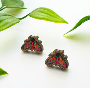Tiny moth studs made from sustainable wood