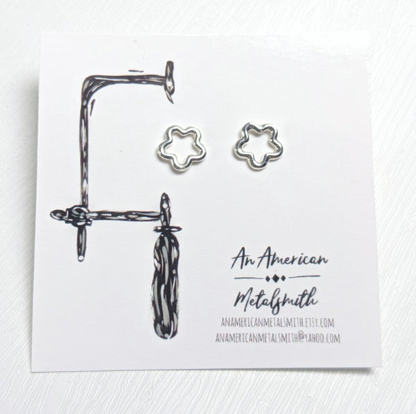 Flower stud earrings made by An American Metalsmith