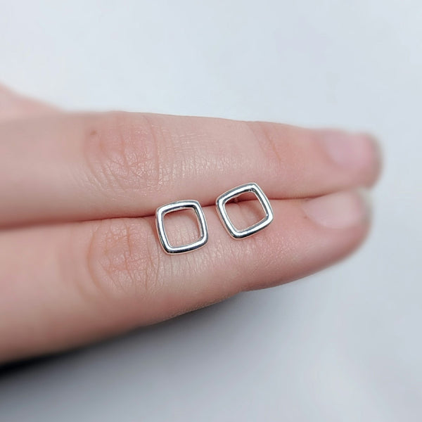 Square stud earrings made by An American Metalsmith