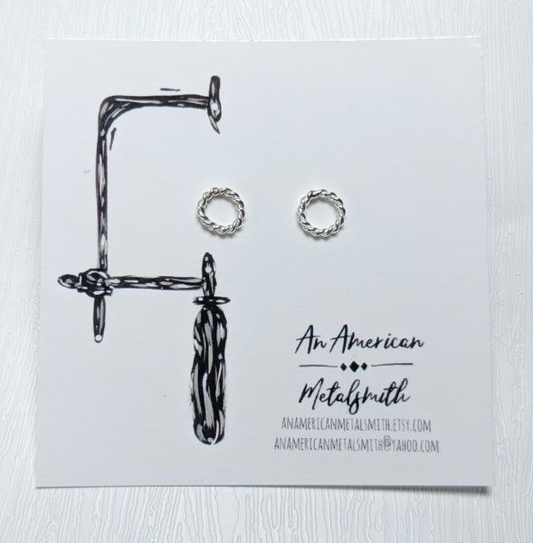 Twisted circular stud earrings made by An American Metalsmith