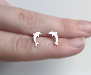 Dolphin stud earrings handmade by An American Metalsmith