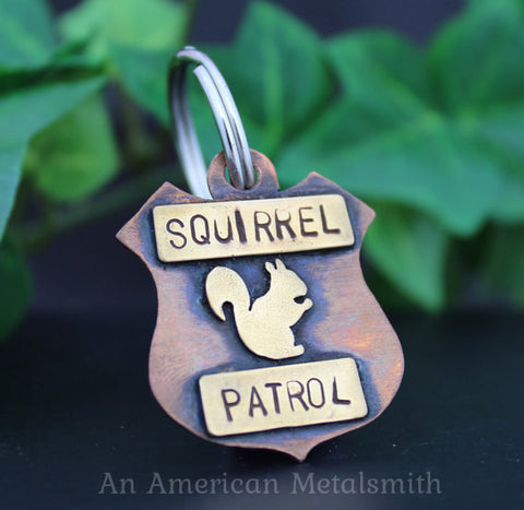 "Copper pet tag with brass squirrel and ""Squirrel Patrol"" stamp made by An American Metalsmith"