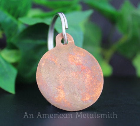 Rear side of a copper pet tag made by An American Metalsmith