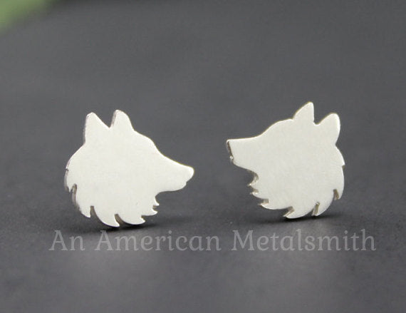 Sterling silver wolf earrings by An American Metalsmith