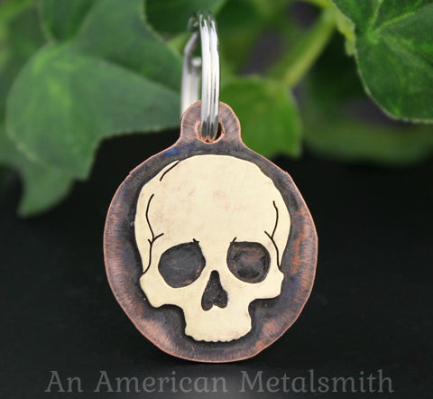 Brass skull on copper piece used as a pet ID tag made by An American Metalsmith
