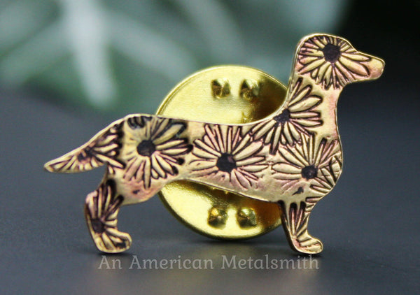 Brass dachshund pin with daisy stamps made by An American Metalsmith
