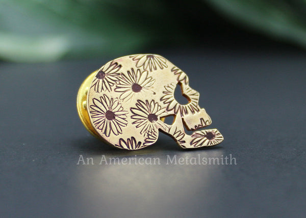 Brass skull pin with daisy print made by An American Metalsmith