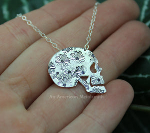 Sterling silver daisy stamped skull necklace handmade by An American Metalsmith