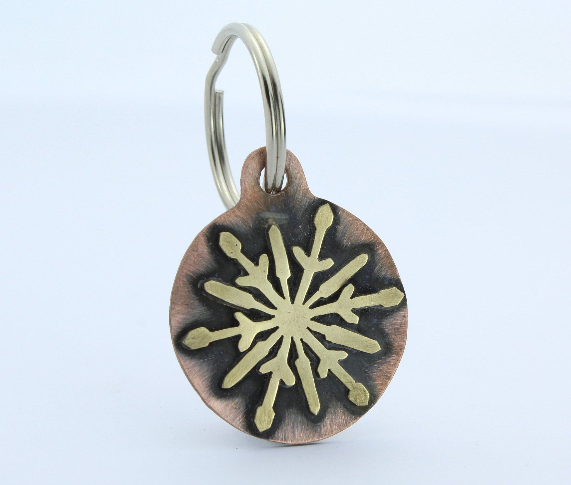 Copper pet tag with brass snowflake made by An American Metalsmith