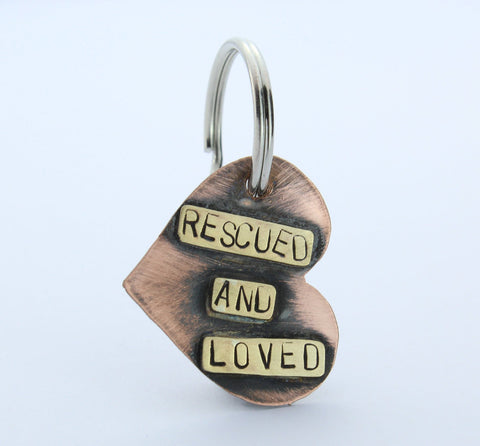 "Customizable Pet ID tag using copper and brass to say ""Rescued and Loved"", made by An American Metalsmith"