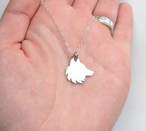Sterling silver wolf necklace handmade by An American Metalsmith