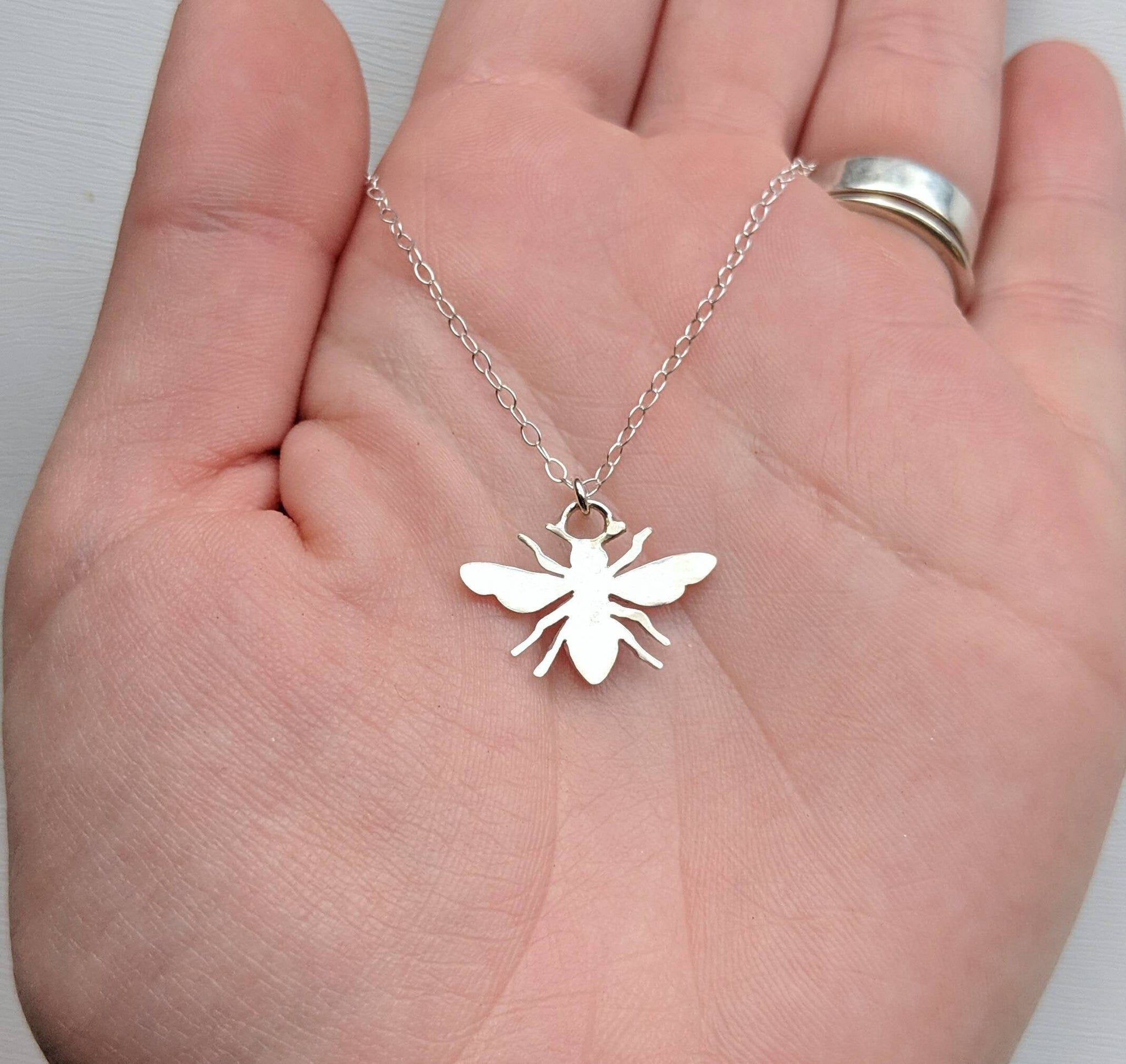 Sterling silver bee necklace handmade by An American Metalsmith