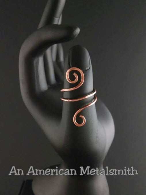 Copper ring, on black mannequin hand, made by An American Metalsmith
