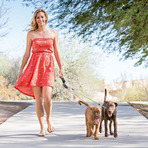 woman walking two dogs with Wigzi Retractable Double Dog Leash