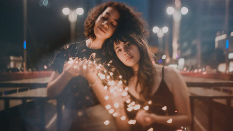 a couple of girl friends with lights