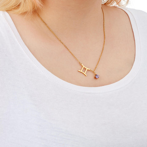 Gemini zodiac necklace on a model