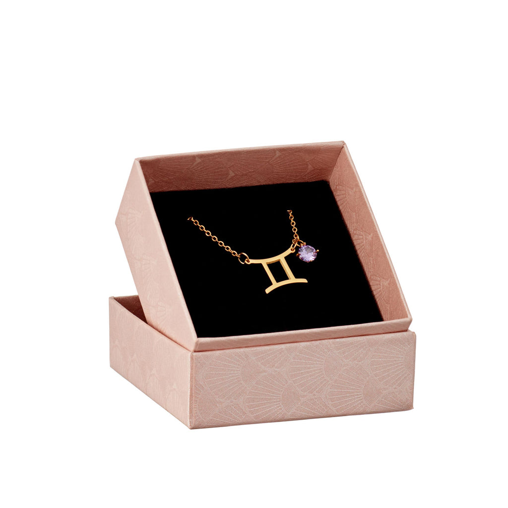 gold gemini pendant and birthstone in a gift box