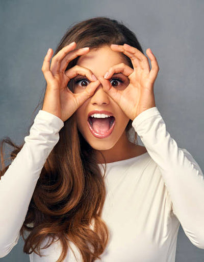 Photo of woman who is excited to learn about Western Optical's new products and discounts by signing up for newsletter