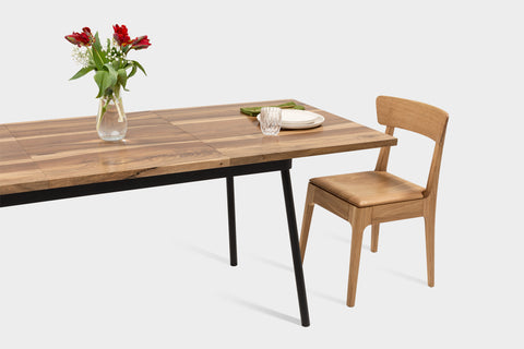 Extendable dining table with wooden chair.