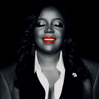 A business mogul, wearing bright red lipstick, basking in GOD's glory!