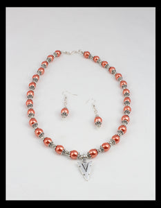 Salmon colored necklace and earring set