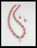 Salmon Colored Necklace and Earrings