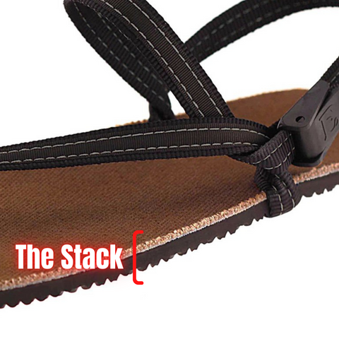 """Three quarters close up of an Earth Runners sandal, with a red bracket around the side of the sole. Neon style text reads """"The Stack."""""""