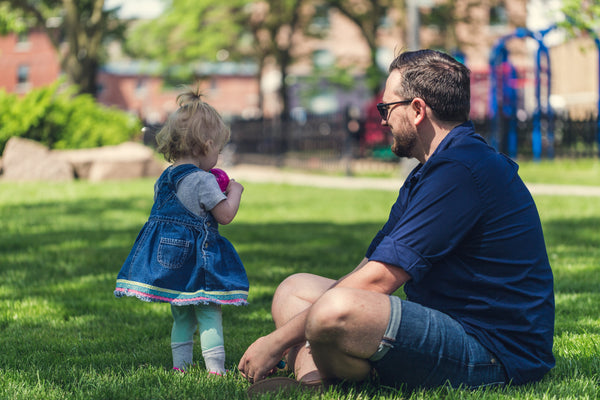 dad and kid at the park