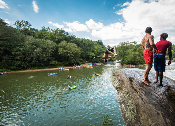 river party with cliff jumping