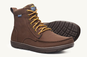 "A pair of Lems vegan boulder boots in ""pinecone"" brown. Right boot is angled to show the front and side and the yellow and brown woven laces. Left boot is set on its side, showing the treads on its outsole."