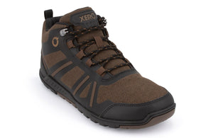 Brown and black hiking shoe at an angle that shows the front and side. Toe cap and sole with deep treads are black and brown. Black shoelaces with brown pattern criss-cross through eight brown lace loops and a pair of silver lace hooks beside the tongue.