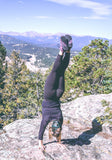 Woman does a handstand on top of a mountain in the DayLite Hiker Fusion Hikers