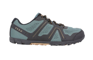 Side view of the Xero Mesa Trail hiking shoe in the colour Forest. Colourway is a mid-tone blue-green with grey and brown accents. Side view shows varied treads along length of shoe.