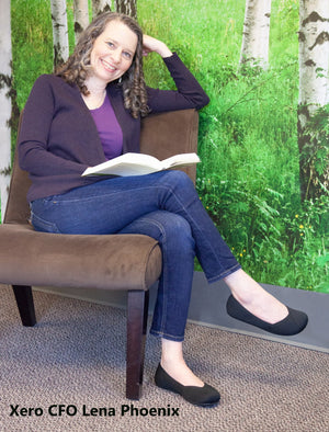 Lena Phoenix CFO of Xero Shoes in her Phoenix Black Knit Vegan Flat Minimal Shoes