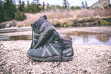 Pair of Spruce Xcursion Fusion HIkers at rocky shallow stream