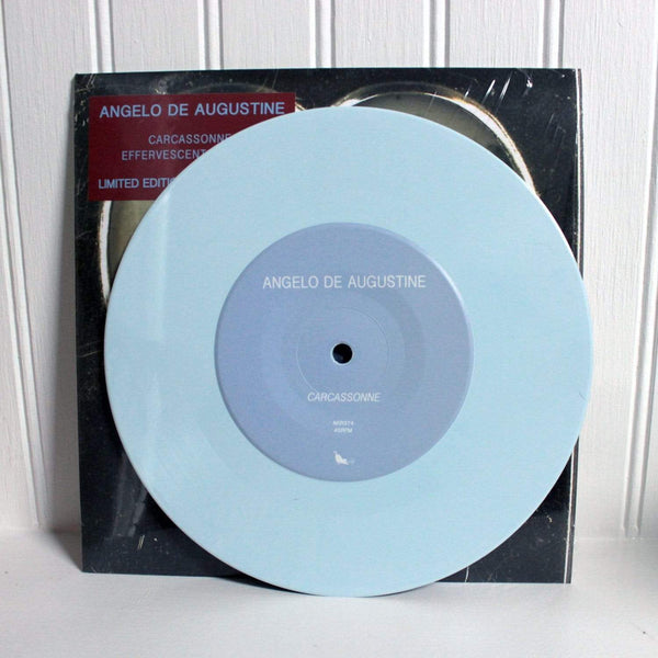 "Angelo De Augustine - Carcassonne (7"" - Sky Blue Vinyl) Asthmatic Kitty Records"