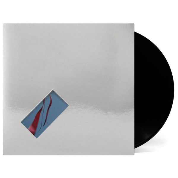 "The xx/Four Tet - On Hold: Remixes (12"") XL Recordings"