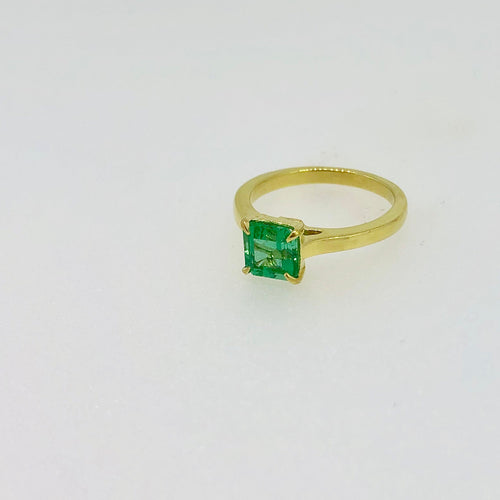 14k yellow gold and emerald ring.