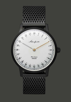 24-hour watch with matte black case and black mesh strap
