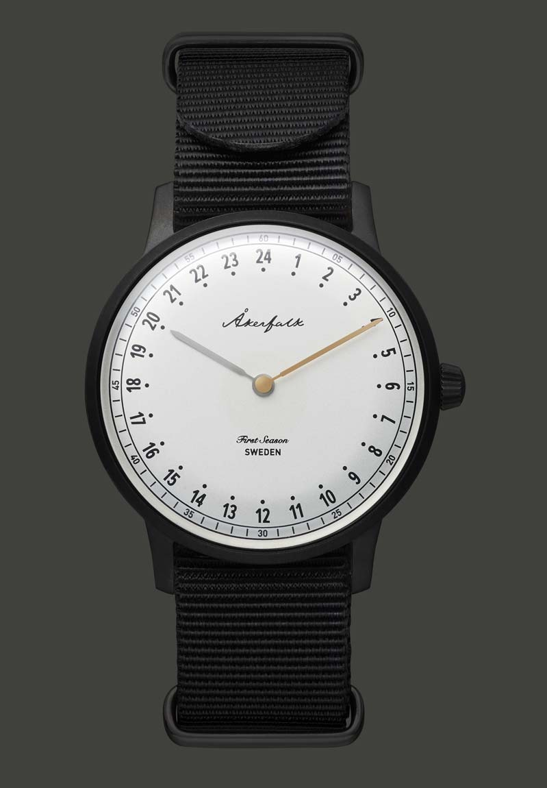 24-hour watch with matte black case and black NATO strap