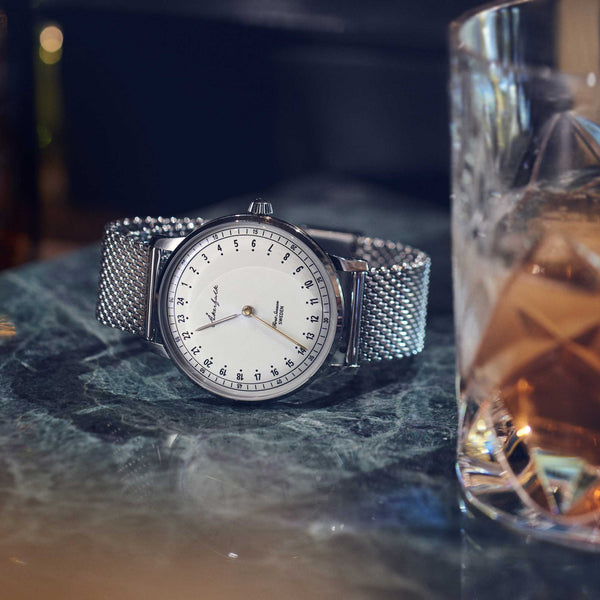 24-hour watch with silver case and silver mesh strap