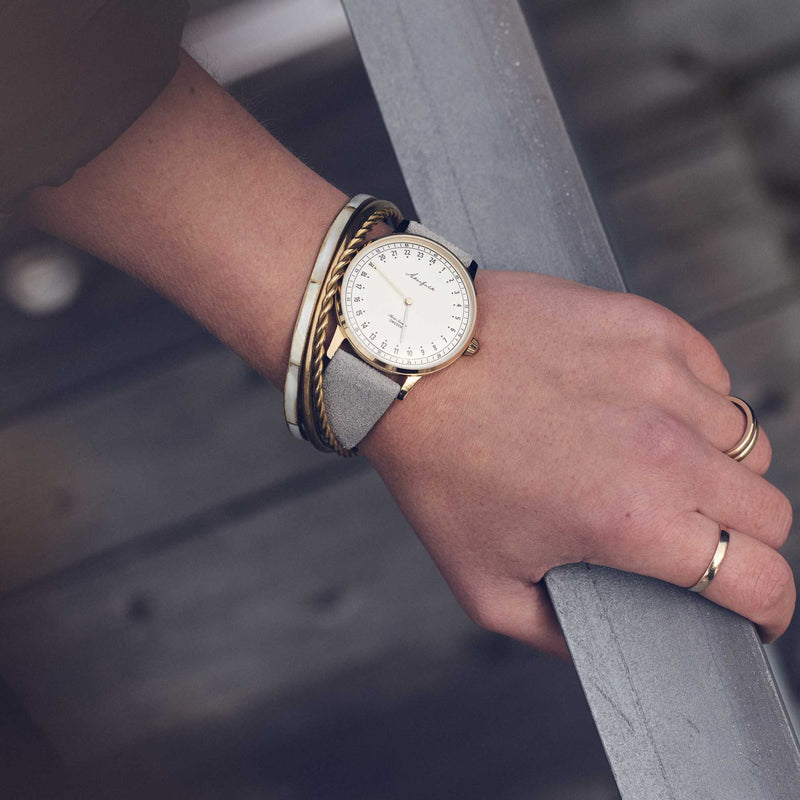 24-hour watch with gold case and grey mocha strap
