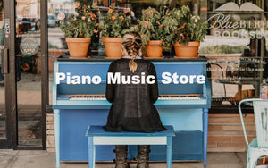 Entry to piano music store, student playing notes on a blue upright instrument