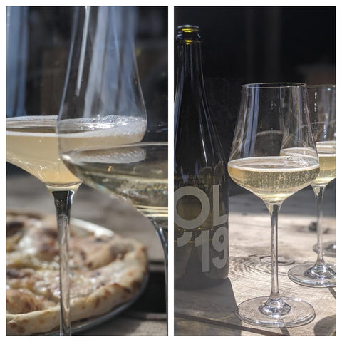 Glasses of Tillingham Col' 19 sparkling wine with garlic pizza in the background